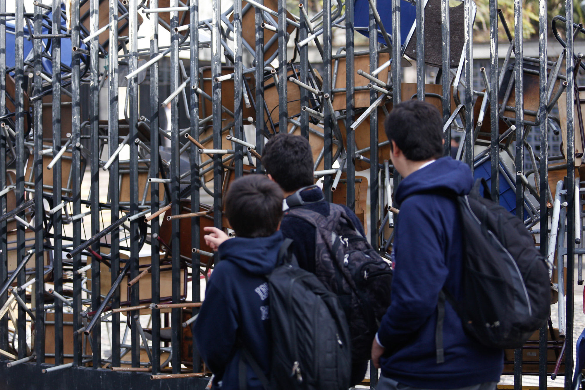 Students outside a blockaded school in Chile.