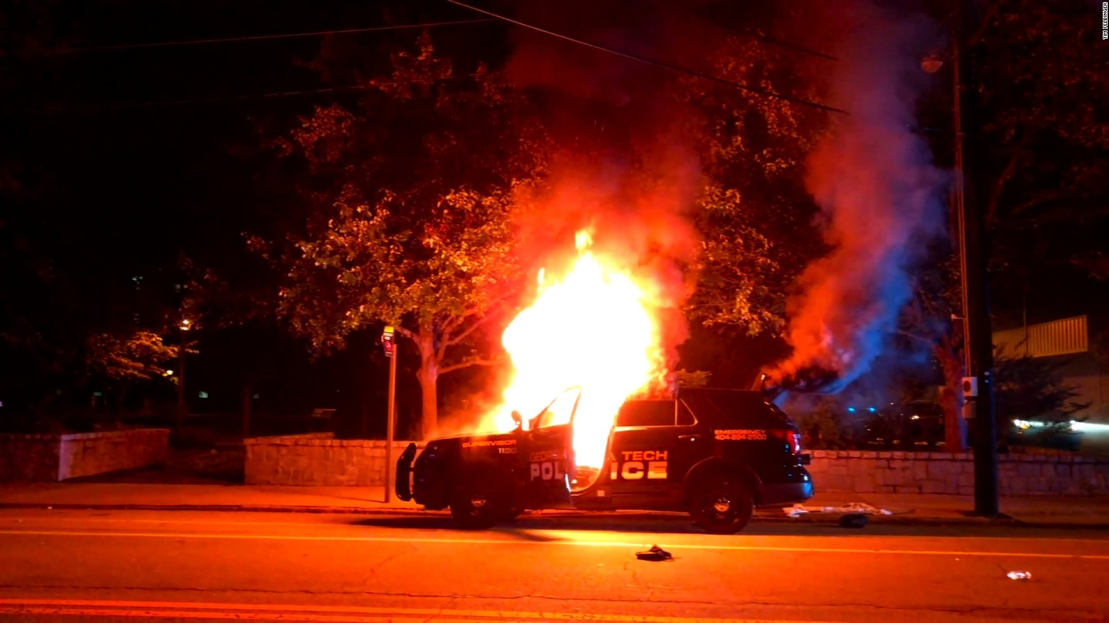 Police car set aflame on September 18 in response to the murder of Scout Schultz.