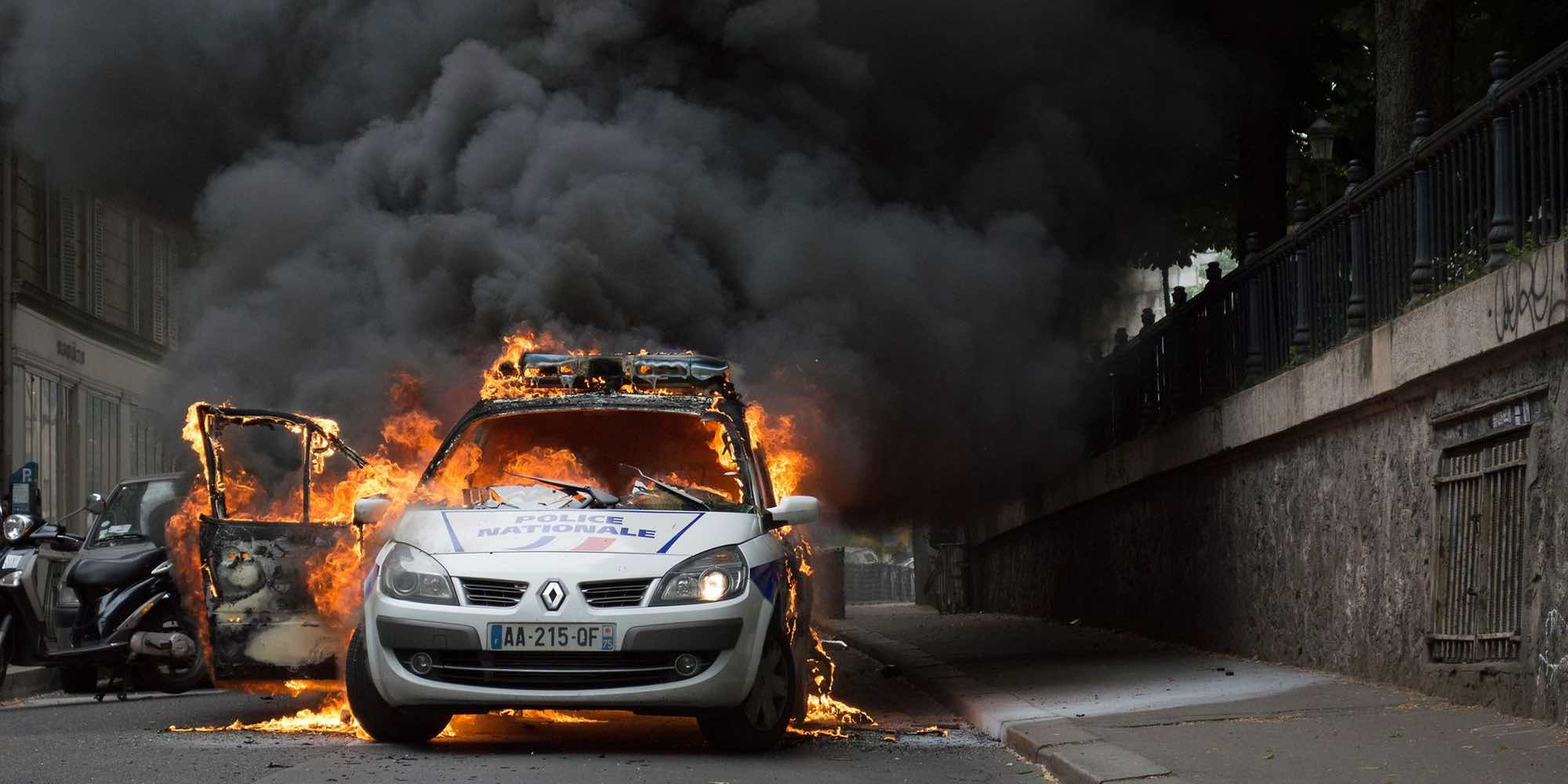 The police car set on fire in Paris in May 2016.