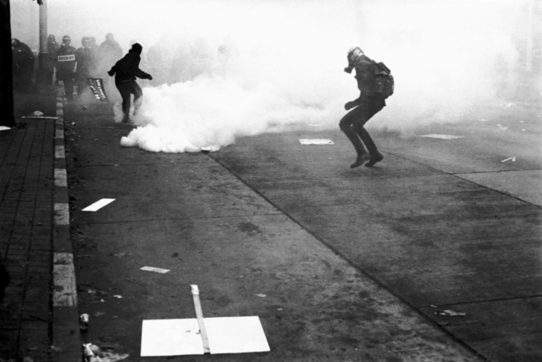 Returning tear gas to the police lines in Seattle, 1999.