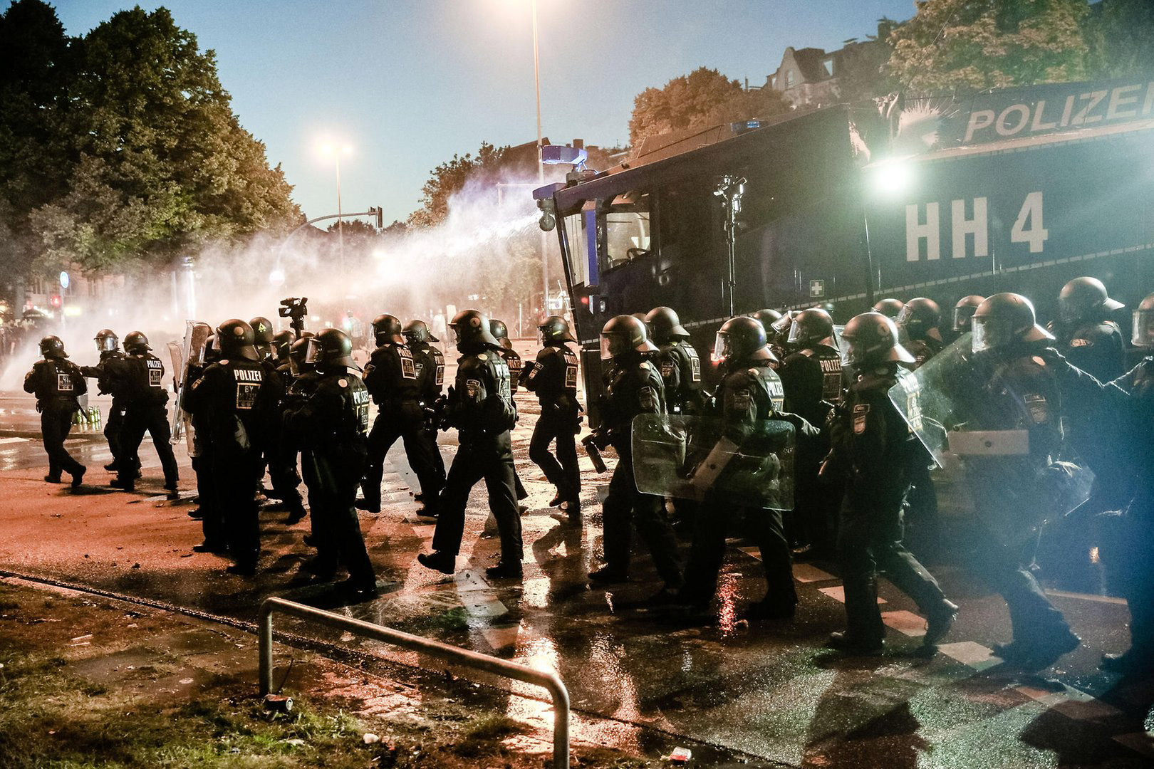Riot police brutalizing the population of Hamburg during the 2017 G20 summit.