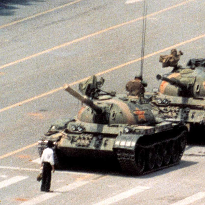 A anonymous man stands in front of a column of tanks on June 5, 1989, the morning after the Chinese military had suppressed the Tiananmen Square protests of 1989 by force, who later became known as the Tank Man. The tanks manoeuvred to pass by the man, and he moved to continue to obstruct them, in something like a dance.